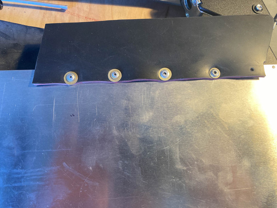 Large head rivets emulated with washers.